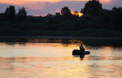 Fisherman silhouette at sunset. Stock Photography