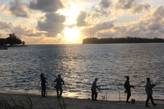 Fisherman. Sillouette fishing men on sunset background Royalty Free Stock Photo