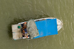Fisherman sitting in aboat Stock Image
