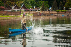 Fisherman in a small boat with his traps on the biggest lake in Royalty Free Stock Image