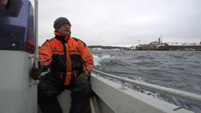 Fisherman on a small boat out to sea to fish in the Baltic sea. stock footage