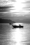 Fisherman Small Boats Sunrise Commencement Bay Puget Sound Water. Boats troll for Salmon awash in bright light at sunset Royalty Free Stock Photo