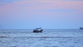 South China Sea With Fishing Boats Stock Footage. Fisherman in a small wooden fishing boat navigating across the south china sea, under tropical sunset skies stock video