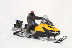 Fisherman on a snowmobile Stock Photography