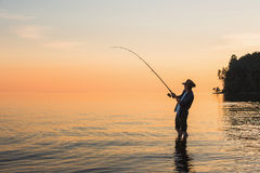Fisherman with spinning Royalty Free Stock Image