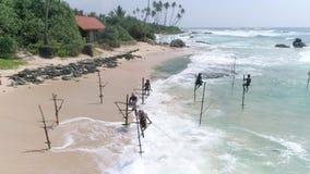 Fisherman Sri Lanka Tropical Aerial 4k. Aerial footage of fishermans at work in Sri Lanka. Slowmotion footage in 4k stock footage