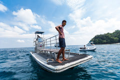 Fisherman Standing on the bow Stock Photos