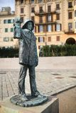 Fisherman statue near the harbor in Savona royalty free stock photos
