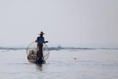 Fisherman at Inle Lake. A fisherman on the still morning at Inle Lake in Myanmar Stock Photography