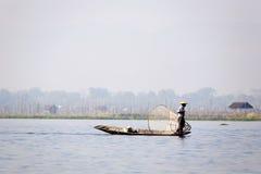 Fisherman at Inle Lake. A fisherman on the still morning at Inle Lake in Myanmar Stock Photos