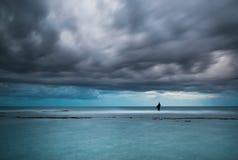 Fisherman in storm dramatic sea royalty free stock image