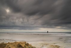 Fisherman in storm dramatic sea stock photos