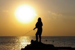 Fisherman in the sun Stock Photos