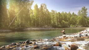 Fisherman in Sun light stock video