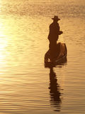 Fisherman in sunlight Royalty Free Stock Images