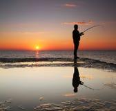 Fisherman at sunrise Stock Photos