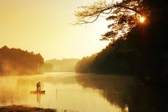 Fisherman in sunrise Stock Photos