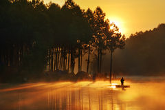 Fisherman in sunrise Stock Photos