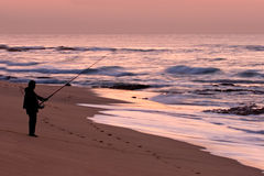 Fisherman at sunrise Stock Photos