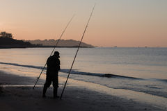 Fisherman at sunrise coasts of the Yellow Sea Stock Photography