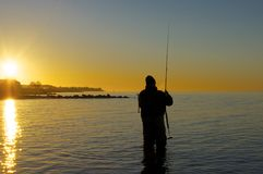 Fisherman in the sunrise Royalty Free Stock Image