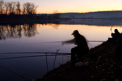 Fisherman at sunrise Stock Images