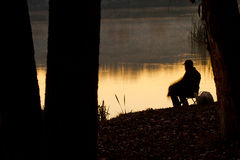 Fisherman at sunrise Royalty Free Stock Images