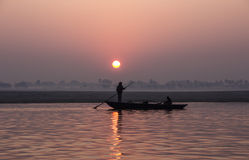 Fisherman at sunrise. A Fisherman at sunrise on the river ganges Royalty Free Stock Image