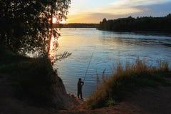 Fisherman at sunseat Stock Images