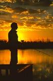 Fisherman at Sunset Stock Photo