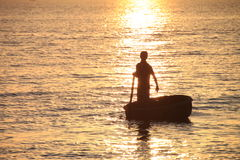 Fisherman in the sunset Royalty Free Stock Images