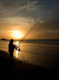 Fisherman at sunset Royalty Free Stock Photography