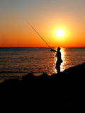 Fisherman at sunset Royalty Free Stock Image
