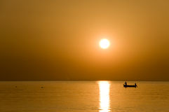 The fisherman at the sunset Stock Photography