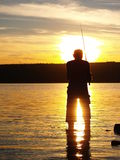 Fisherman in sunset Stock Photography