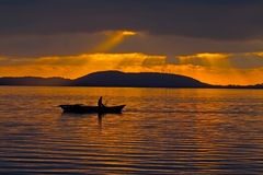 Fisherman During Sunset Royalty Free Stock Photo