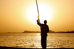 Fisherman at sunset Royalty Free Stock Photo