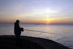 Fisherman at Sunset Stock Photos