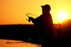 Fisherman at sunset Royalty Free Stock Photos