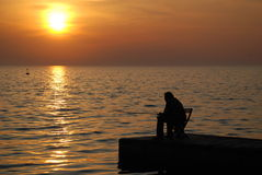 Fisherman sunset. Fisherman on a dock during sunset in Pirano (Slovenia Stock Photography