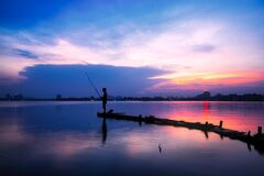 Fisherman at sunset Royalty Free Stock Images