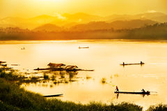 Fisherman in sunset background Stock Photos