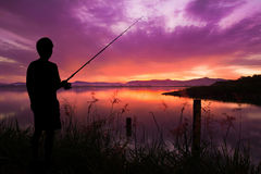 Fisherman at Sunset Stock Photo