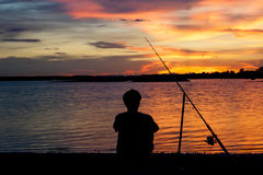 A fisherman in sunset. Royalty Free Stock Photo
