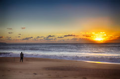 Fisherman and sunset Royalty Free Stock Image