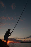 Fisherman at sunset Stock Image