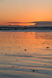 Fisherman at sunset. Fisherman silhouette at sunset with orange colors stock image