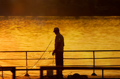 Fisherman in the sunset Royalty Free Stock Image