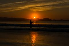 The fisherman at sunset. royalty free stock images