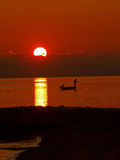 Fisherman in sunset 1 royalty free stock photo